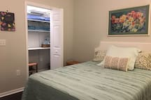 Walk-in closet not only holds guest clothes, supplies, and suitcases, but is also a handy location for coffee, tea and water; extra towels, pillows and blankets; a fan, space heater, and other necessities.