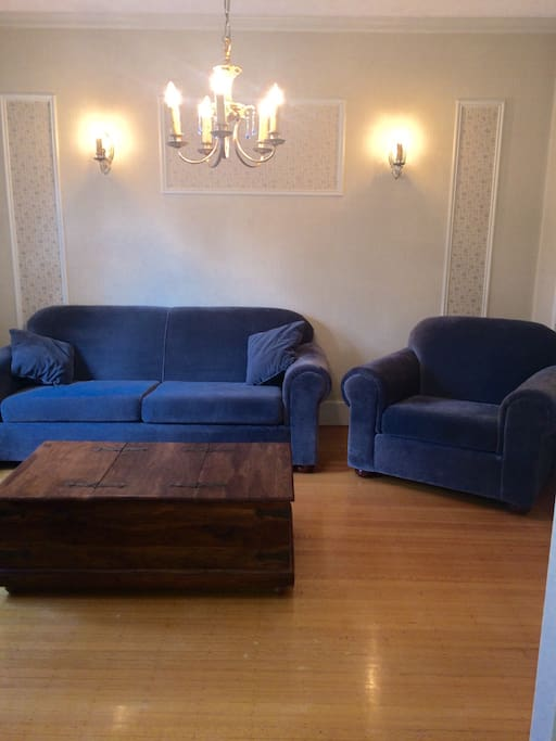 Living room with sofa chair media table TV rosewood coffee table