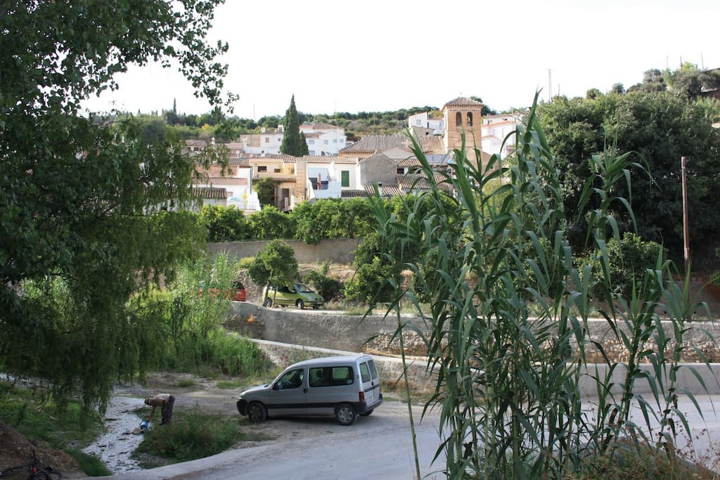 A three storey town house with pool in Saleres - overlooks an orange grove and small stream.