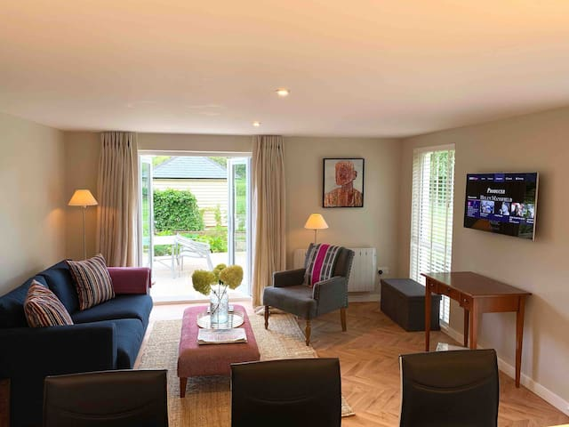 Living room - beautiful views over the garden and countryside. This is a relaxing space with Smart TV and Sofa bed