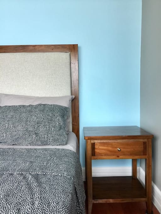 Bedroom with queen-sized comfortable bed & fresh linens for a good night's sleep.