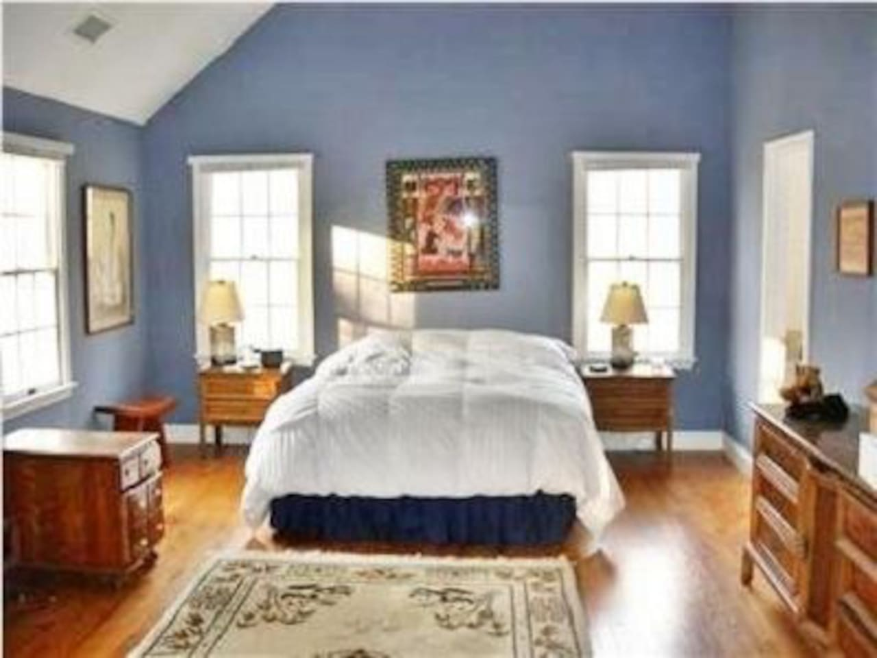 Bright spacious master bedroom with king sized bed