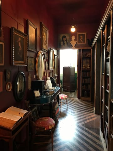 The hallway to the Clark Room. A portrait gallery and library filled with antique books and oddities.