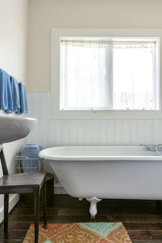 Bathroom on the first floor has a claw foot tub for pure relaxation.  Bubble bath and epsom salt included !