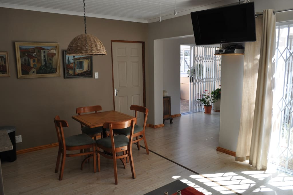 Lounge, kitchen and dining room with flat screen TV. shared with one other guest