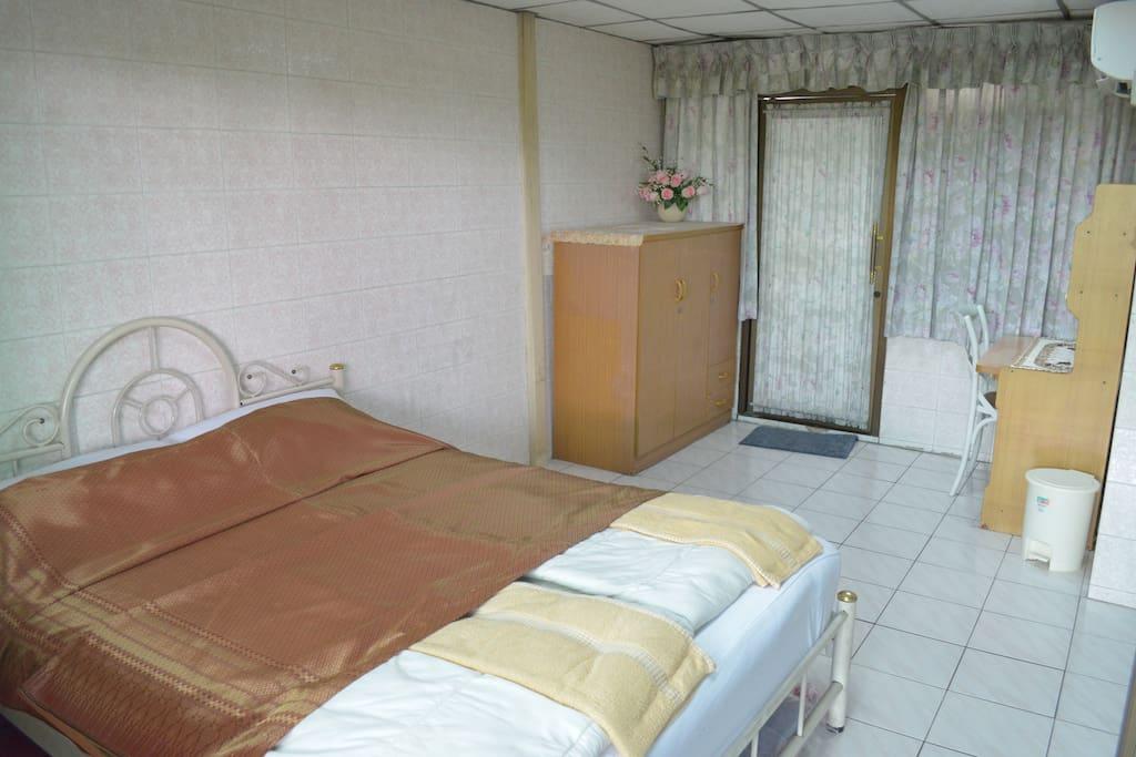 Queen Room with a little garden balcony.