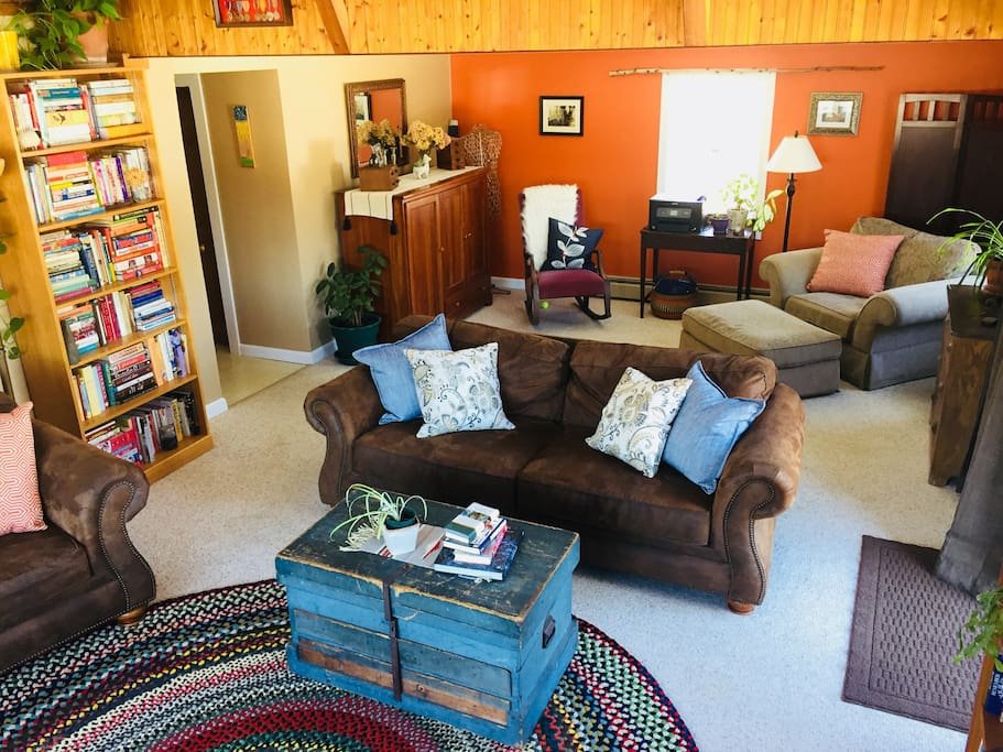 The living room and back sitting area allow plenty of options to sit and relax, read, or do yoga/meditate.