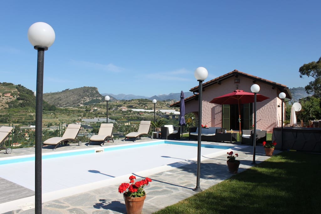 The villa and pool and view to the Alps.
