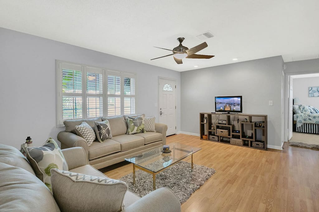 """The living room offers comfortable seating for unwinding with a movie on the 32"""" flat screen TV with a Roku player."""