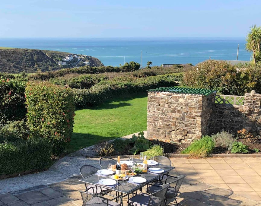 Private garden with stunning views of the Atlantic, Cornwall hills and Sunset.