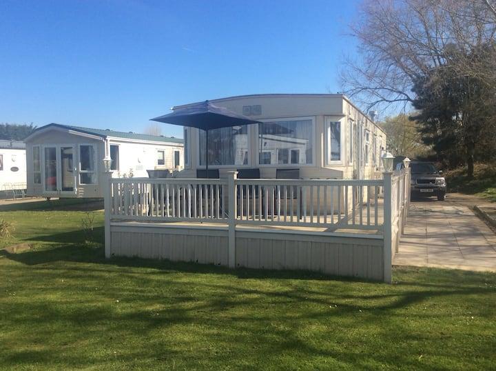 Fully equipped spacious caravan with gated veranda