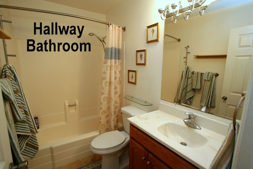 Hallway bathroom is shared with just one other room.