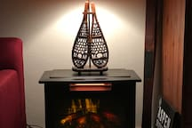 The electric wood stove adds warmth and ambiance