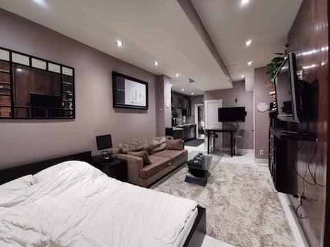 Main floor fabulous furnished 1 bed unit  backyard