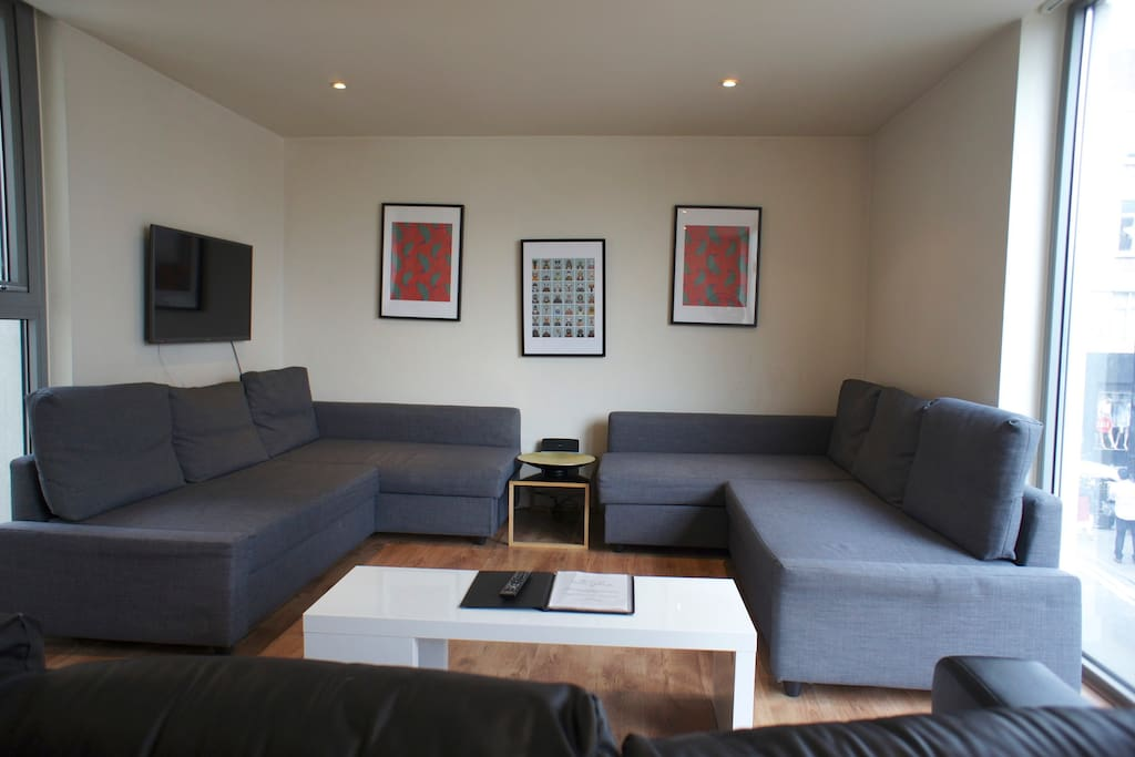 Here's the living room with two double sofa beds