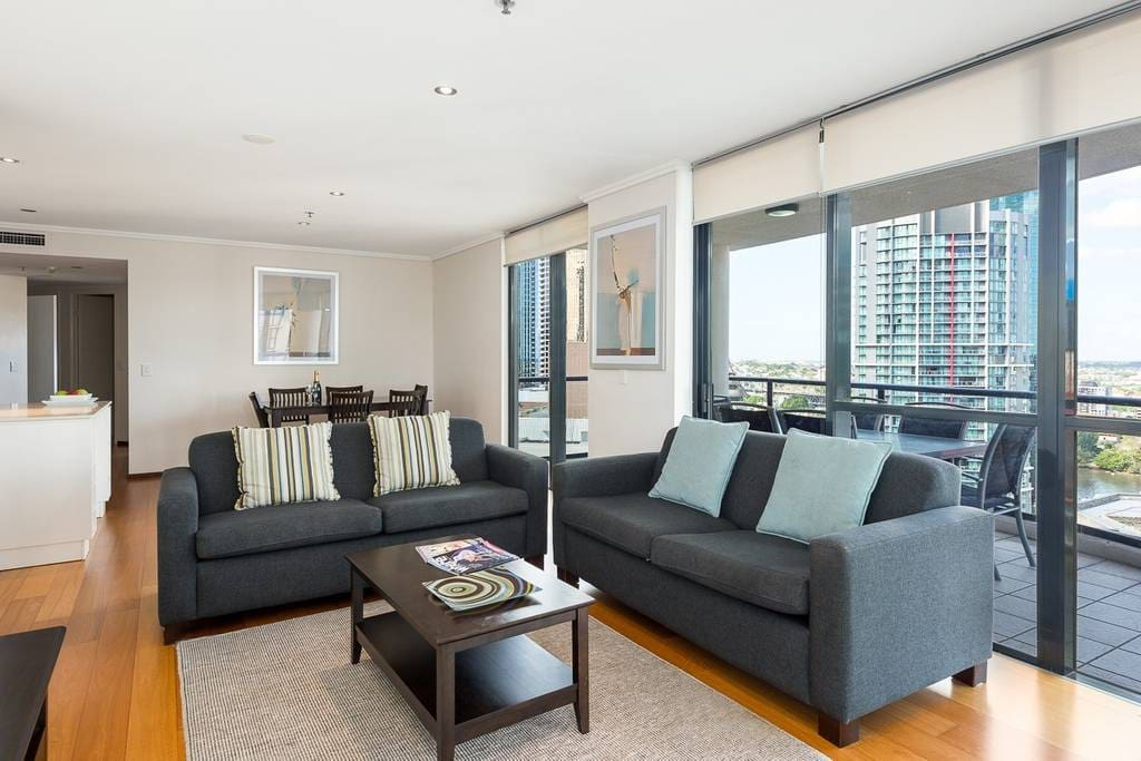 Spacious lounge room with great city views