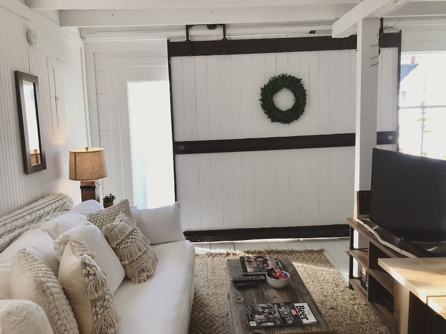 Barn door slides to access floor to ceiling glass doors with views of the front yard and lets in lots of light or close to have complete privacy!