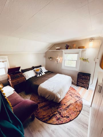 A view of the music room with a brand new guitar, ukulele, small drum and maracas - maybe you're feeling like serenading your love or finally exercising those musical muscles!  Also the futon pulls out to a full/double bed for 2 people.