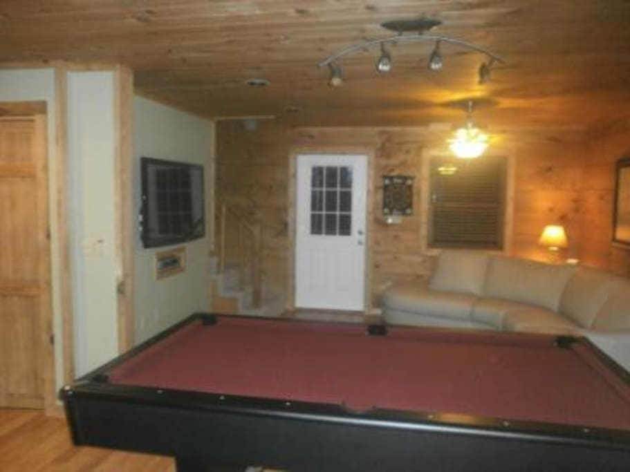 Large game room area for hours of fun & excitement. Pool table coverts into ping pong table.