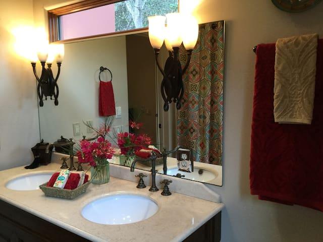 Bathroom has double basin sinks
