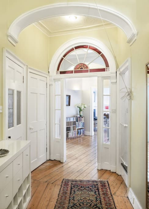 A large entrance hall leads onto a central hall from which there is access to the kitchen diner, living room, and bedrooms.