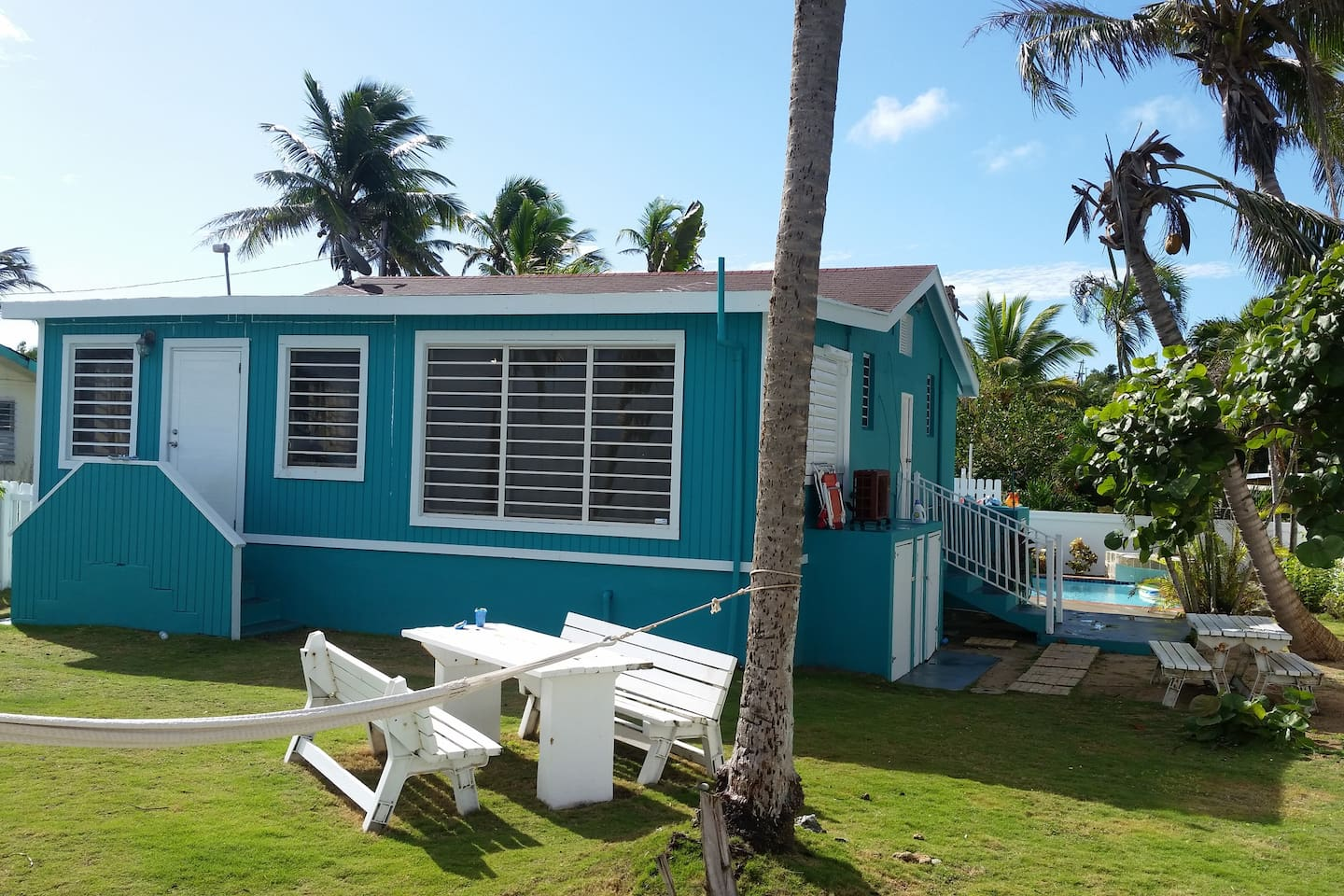 Cozy 3 bedroom bungalow has a peaceful yard to relax in & enjoy sound of waves