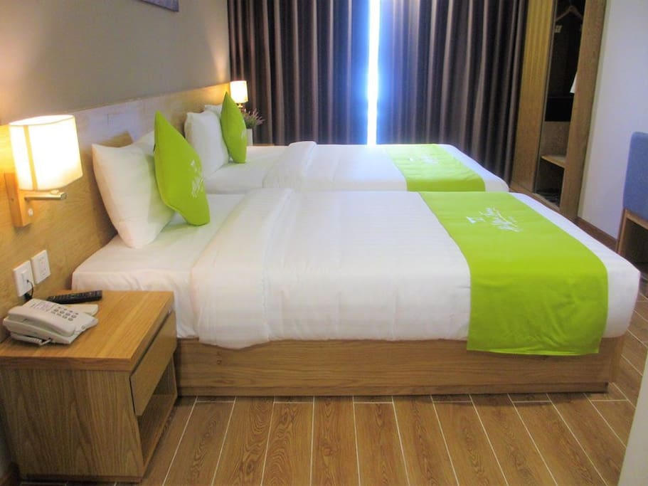 2 beds : 1 single and 1 double equipped with air-con, safebox, working desk, television, tea, coffee, kettle. Bathrobe with  balcony.