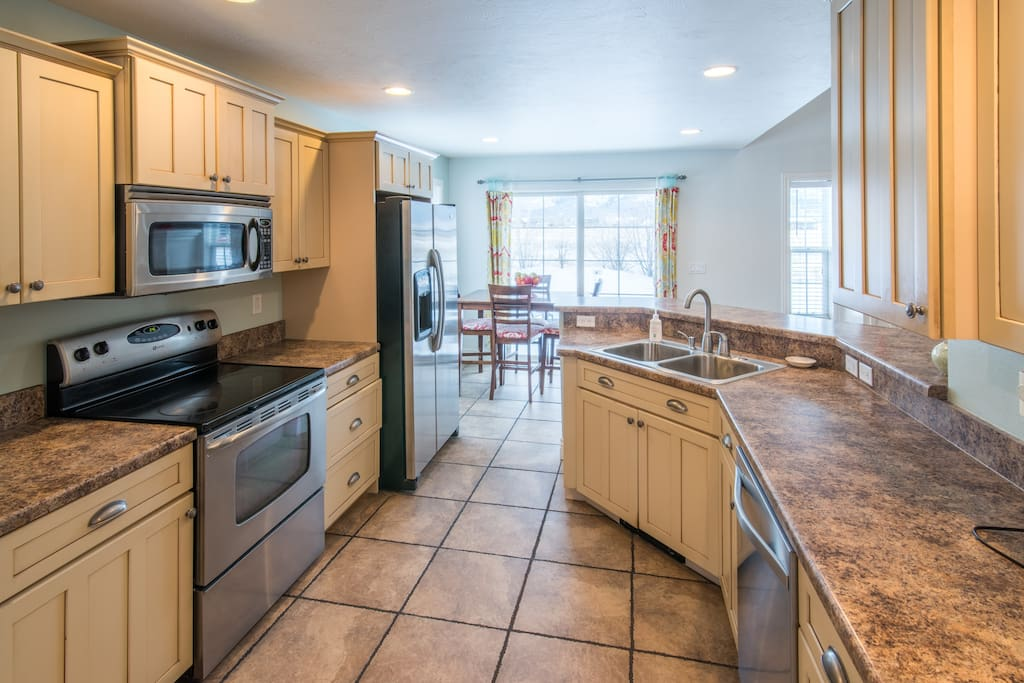 Whip up a tasty meal in the charming kitchen that opens up to the living area, and connects to the dining room.