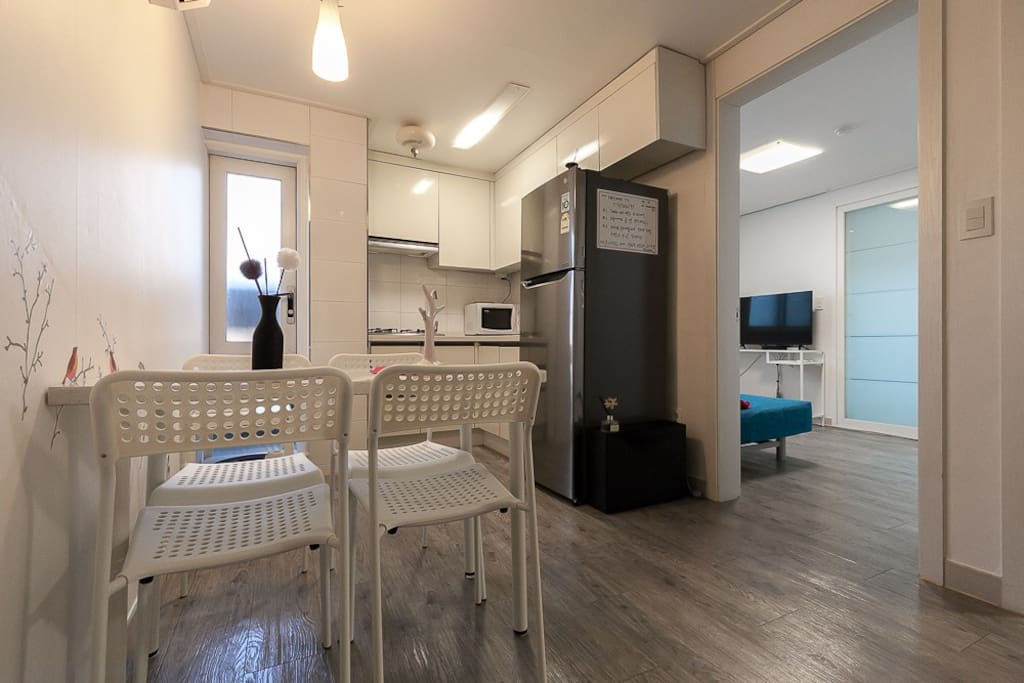 Kitchen with a dining table with 4chairs