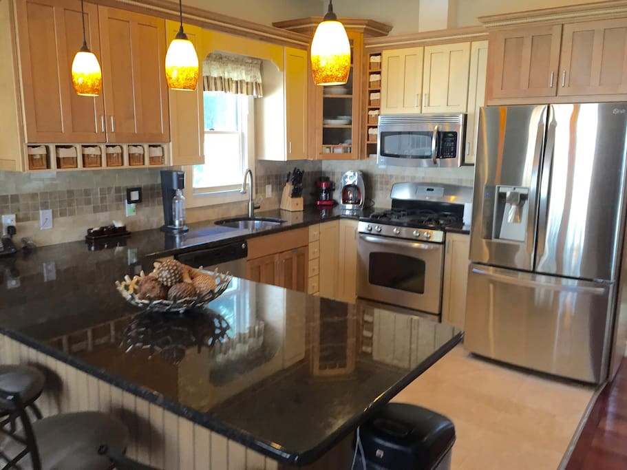 Gourmet kitchen with stainless steel appliances including a wine fridge.