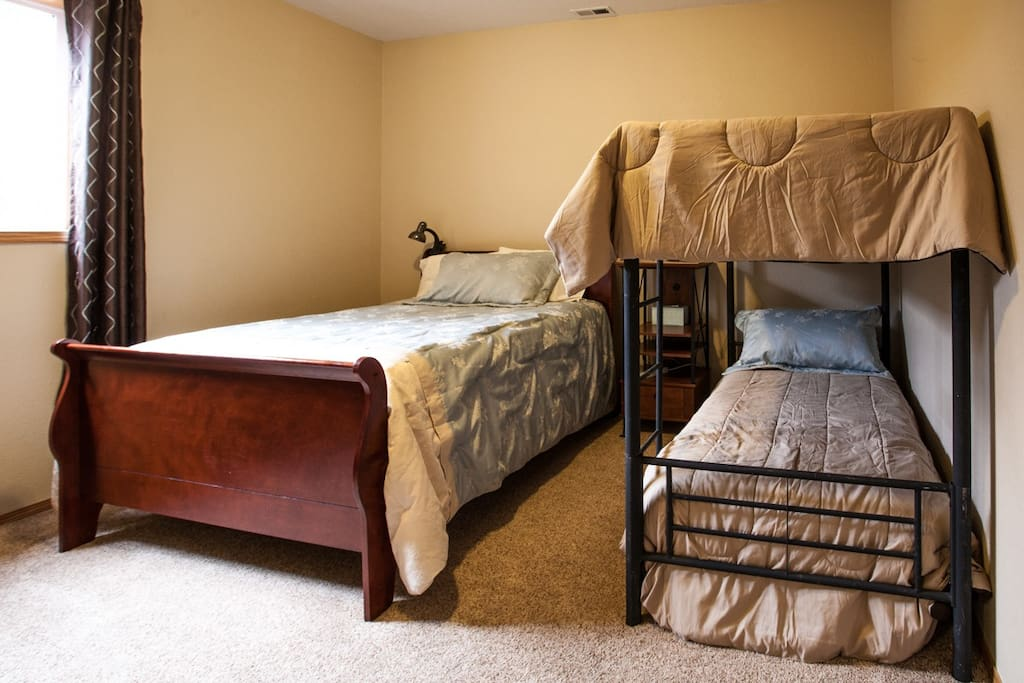 MIL Suite - This bedroom with vaulted ceilings has a queen bed  plus a twin bunk bed.