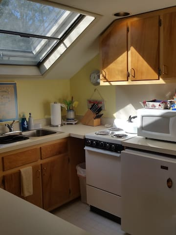 Kitchen/coffee maker/microwave /stove/oven, small fridg. Fully stocked with dinnerware and cookware.
