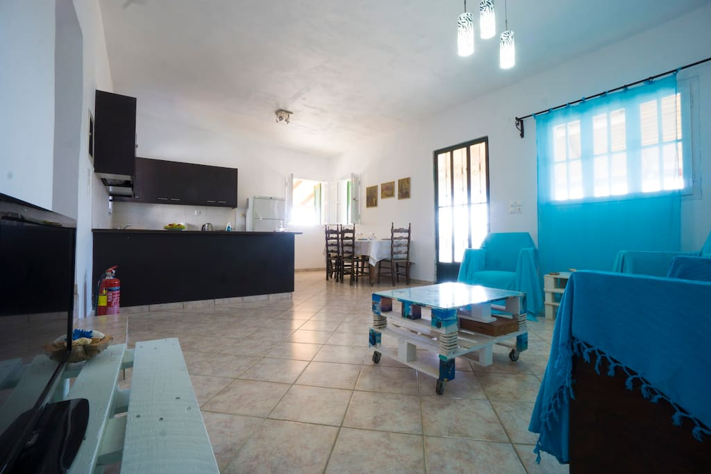 Open space living room, dining room and kitchen! Comfortable and spacious with air condition!