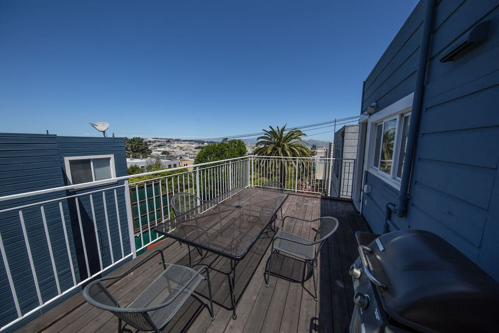 The DECK! Stocked with grill and patio furniture. Beautiful views of the Richmond district. On a clear day you can see the Golden Gate Bridge.