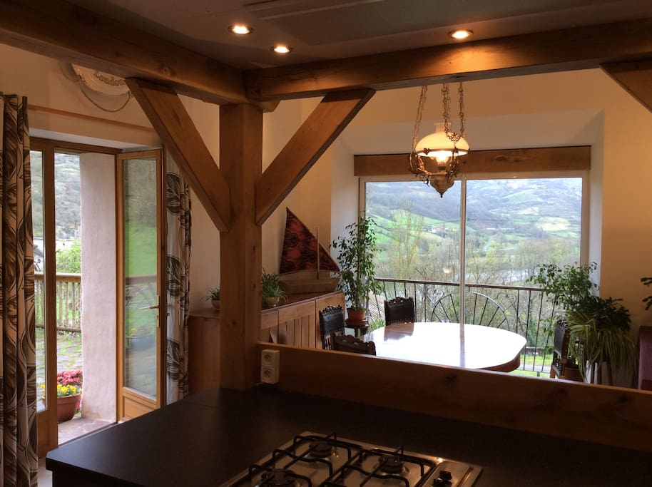 Spacious kitchen dining room with stunning views leading onto the terrace and garden