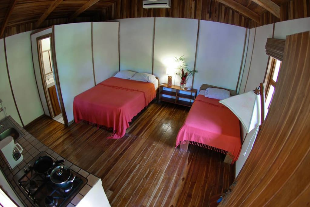 A queen bed and a single bed