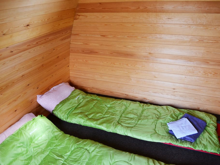 Camping pod sleeping with sleeping bags and mats