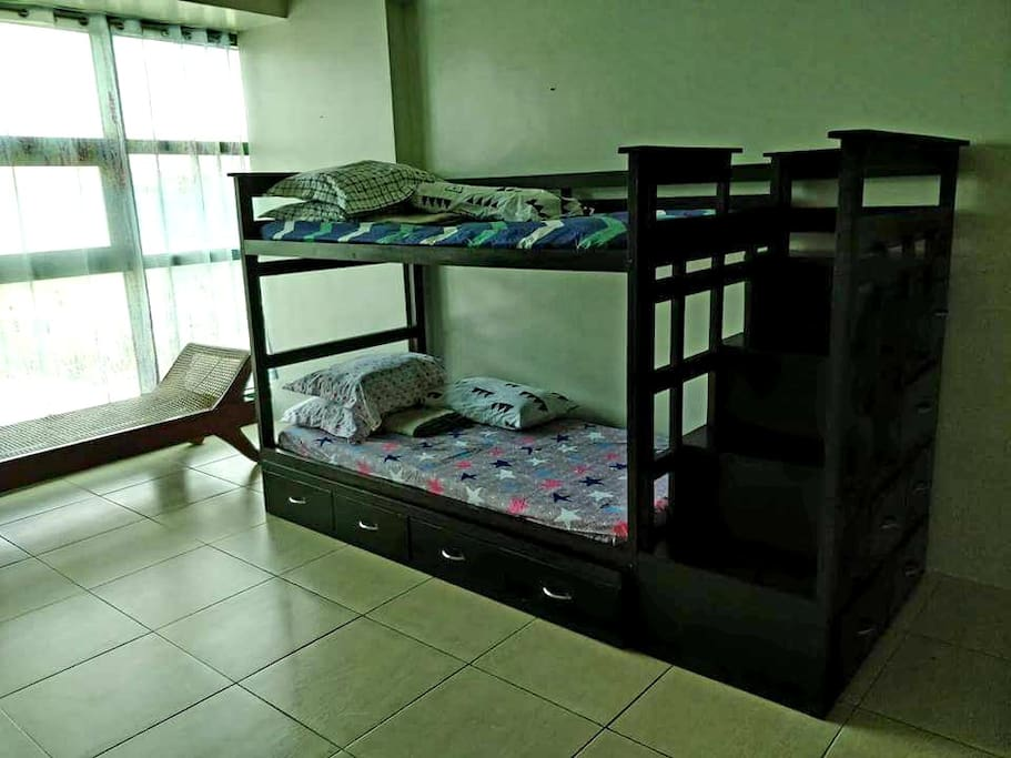with double deck bed, another one under pulling bed