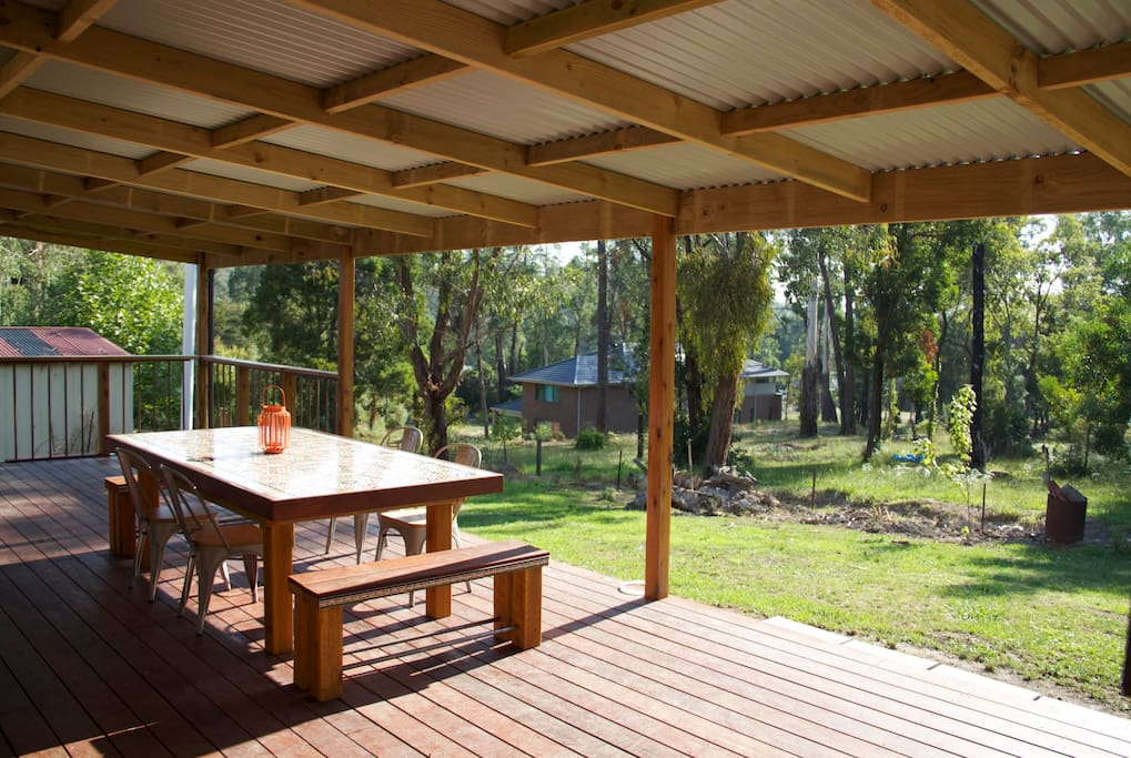 Large outdoor deck and summer eating area overlooking bushland. Seating for 8.