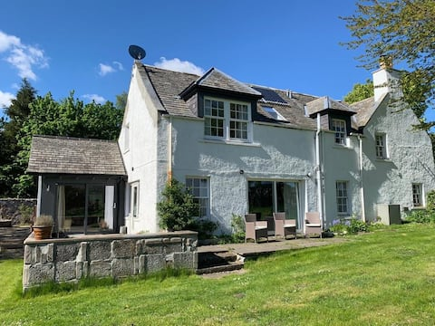 Historic farmhouse located in Scottish Highlands.
