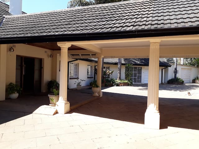 The Front Entrance to the Villa includes covered parking space.