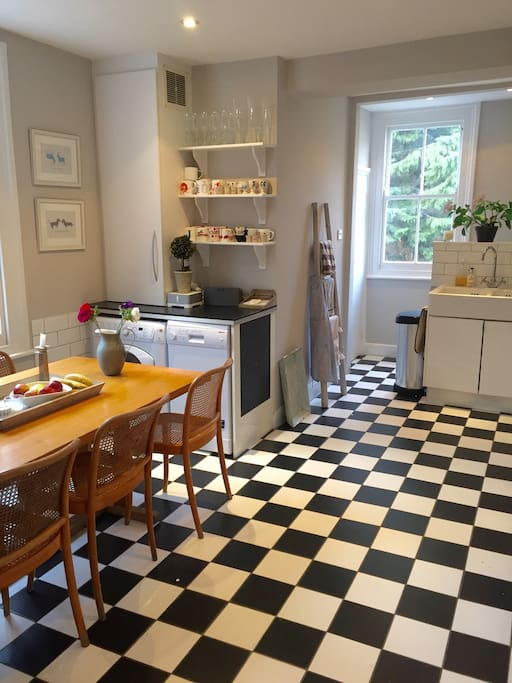 Large, light kitchen with a dining table that seats 8.