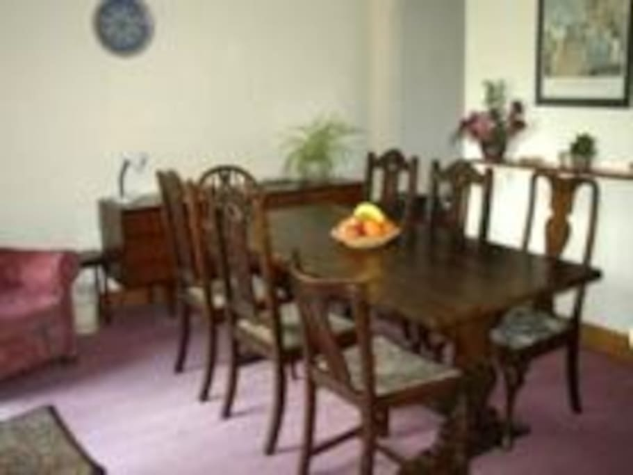 Plenty of room round this table for 8 people.  Double patio doors lead to the garden.