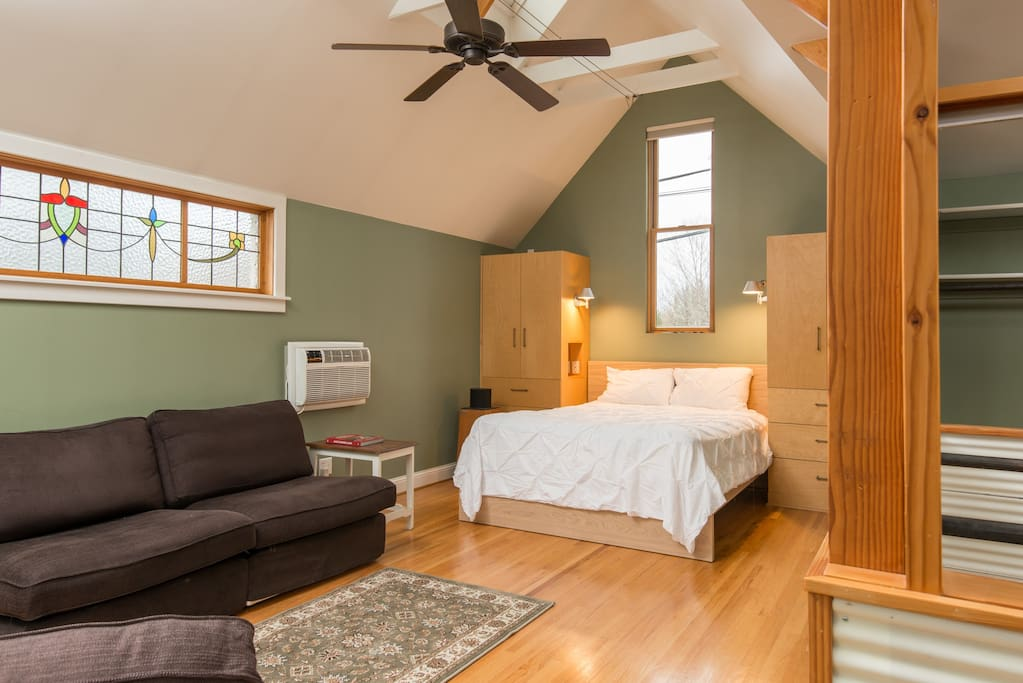 Master Bedroom Suite with a Queen bed, two couches, gas fireplace and Juliette Balcony