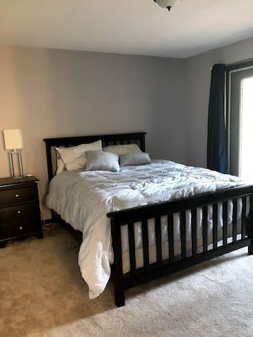 Bedroom 2 (queen) upstairs with balcony, TV