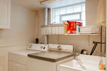 In the kitchenette there is a washer, dryer, and kitchen sink. We provide laundry detergent and other cleaning items.