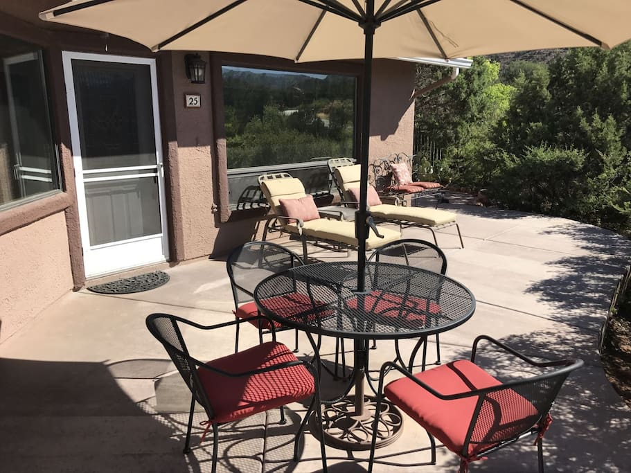 patio in front of home set up for lounging or dining. Watch the sunset on Cathedral Rock.