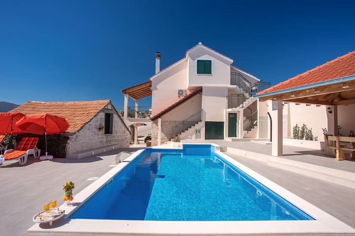Beautiful pool with water massage function  and west side of the house.