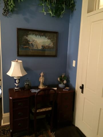 Antique furnishing throughout the room.
