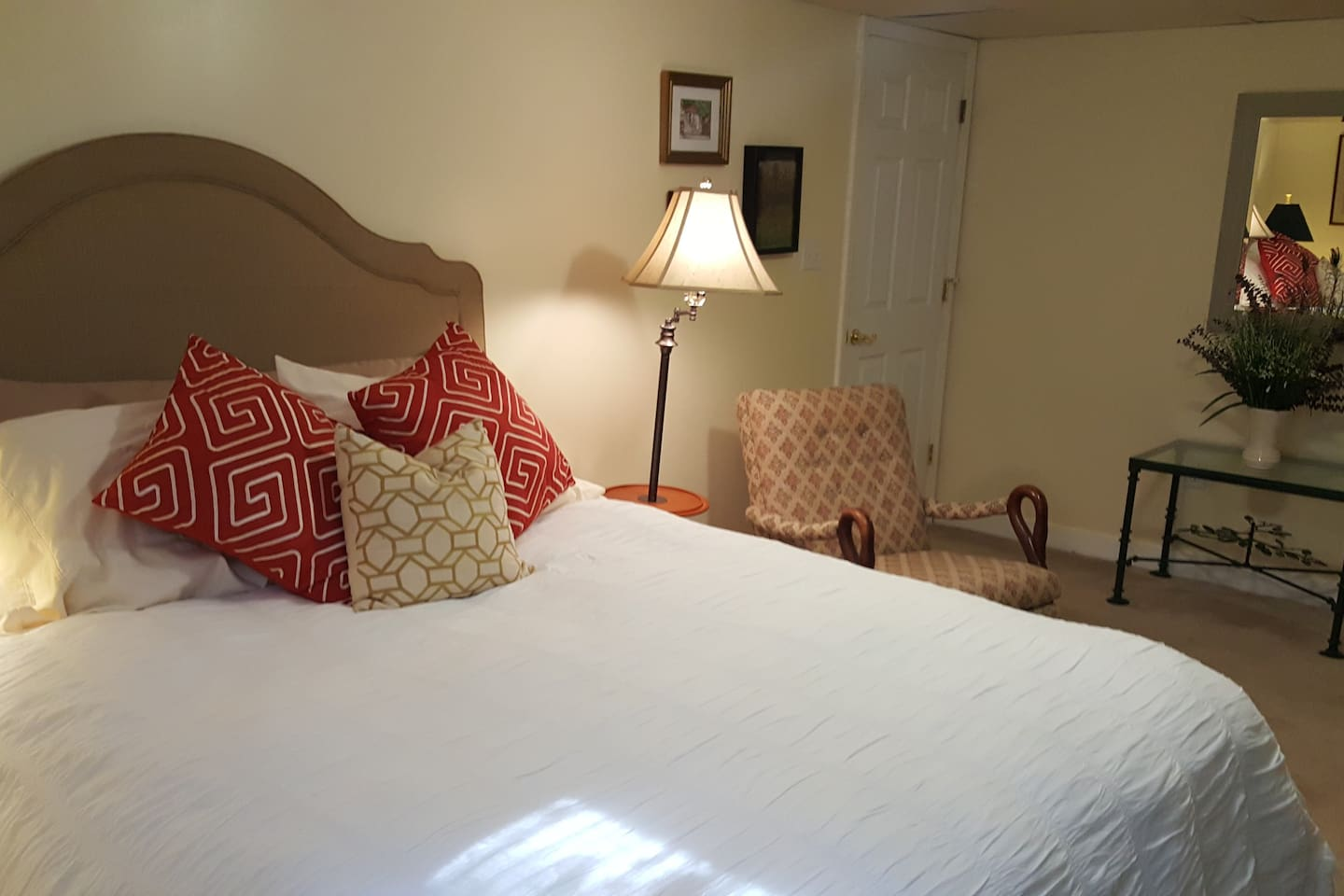 Private bedroom with super comfy queen bed, ample reading lights, and space to relax in complete privacy.